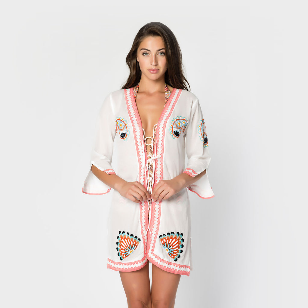 Photo of the front of a long-sleeve tie-front tunic from Letarte.  Letarte sells bikinis, swimwear, cover-ups and other resort fashions.