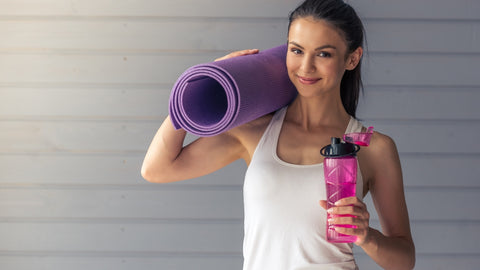 woman carrying a large exercise mat