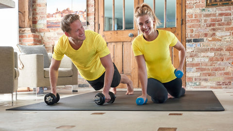 man and woman working out on large exercise mat