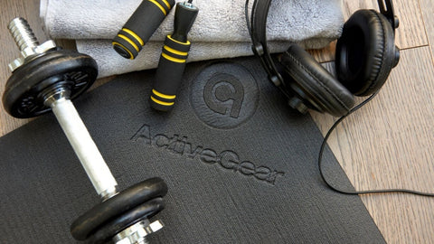 workout equipments on large exercise mat