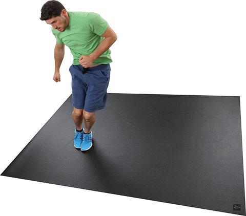 Man using a black workout mat for home gym