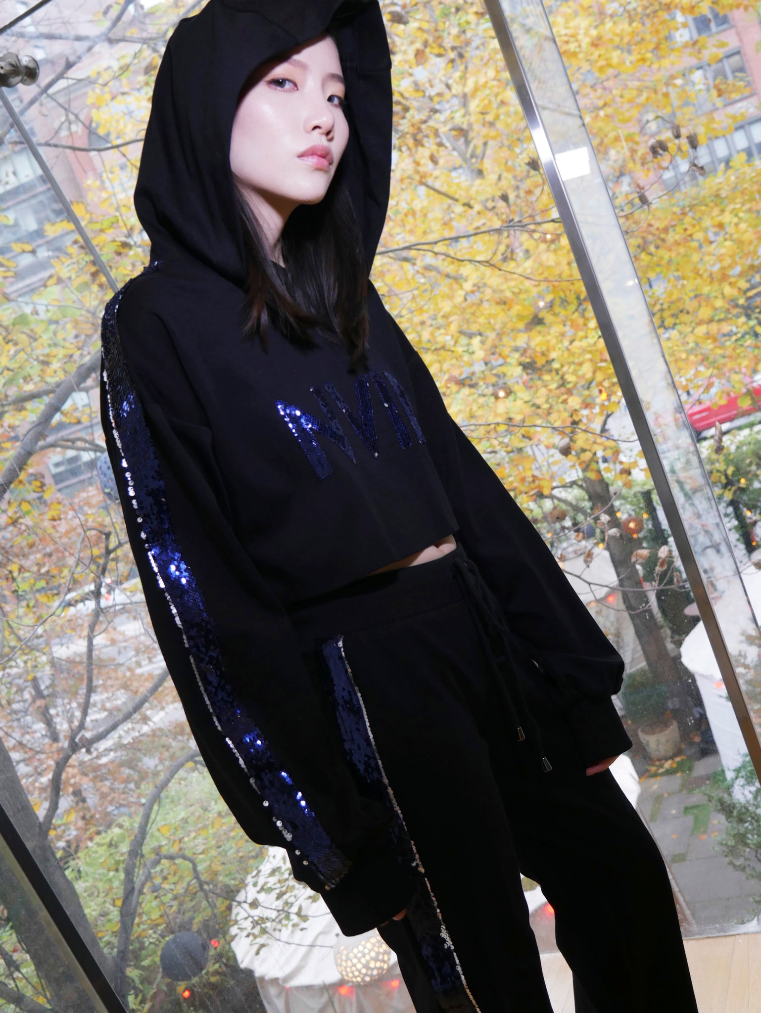 NOMAD VII - NVII SEQUIN HOODED CROP TOP - NOMAD VII X ANNE BOWEN