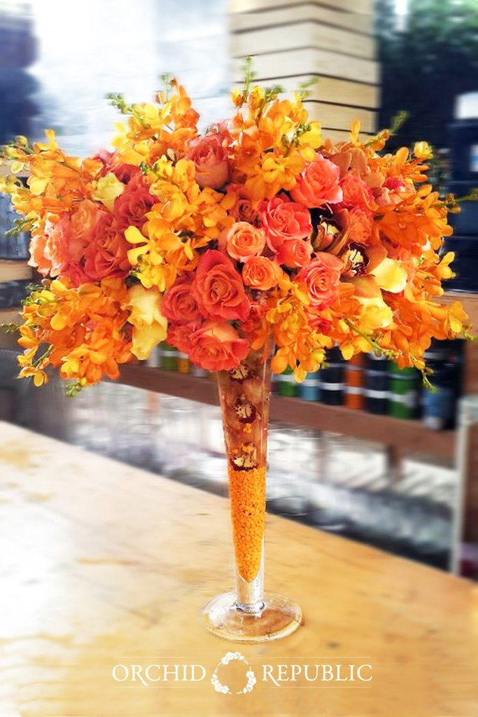 orange floral madness flower arrangements
