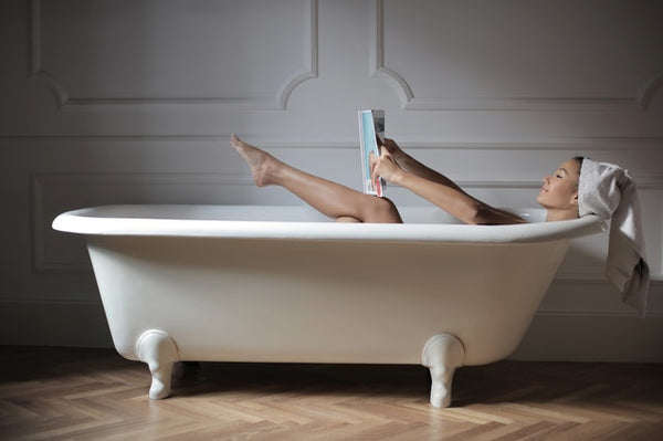 Woman in Bath with a Book