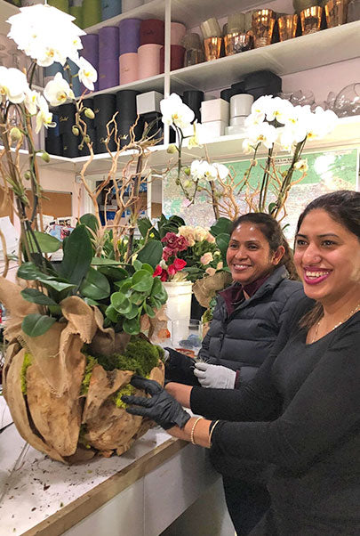 People at work with Orchid Arrangements