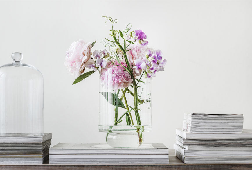 Springtime flower arrangement with pink peonies and orchids