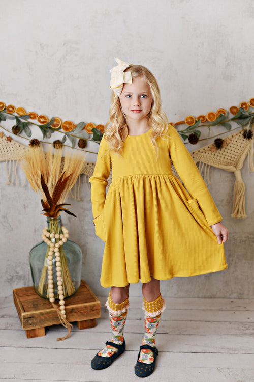 RIBBED BALLET DRESS IN MARIGOLD