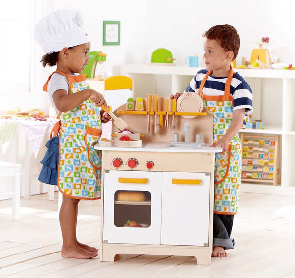 Gourmet Kitchen + Starter Set. Note: Food toys not included