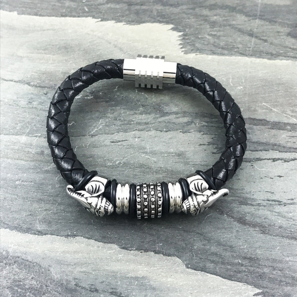 Stainless steel Ganesha and studded stopper on a black woven leather bracelet