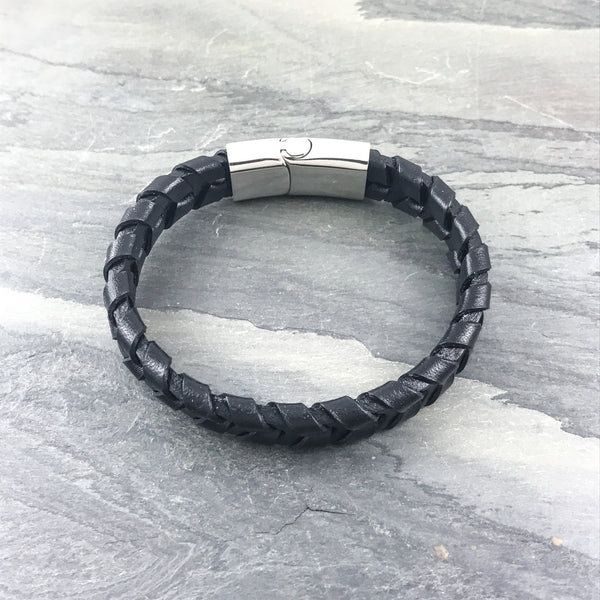 Black leather woven bracelet on slate