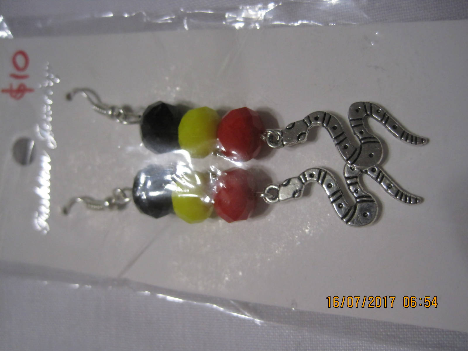 Snake totum earrings