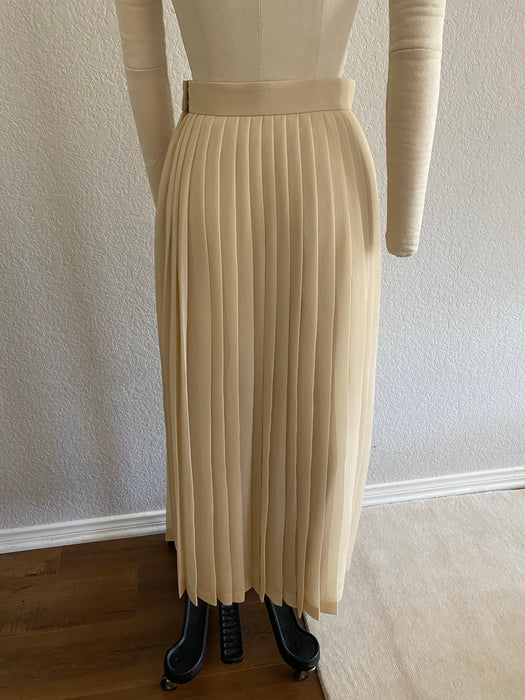 The Row cream colored pleated skirt