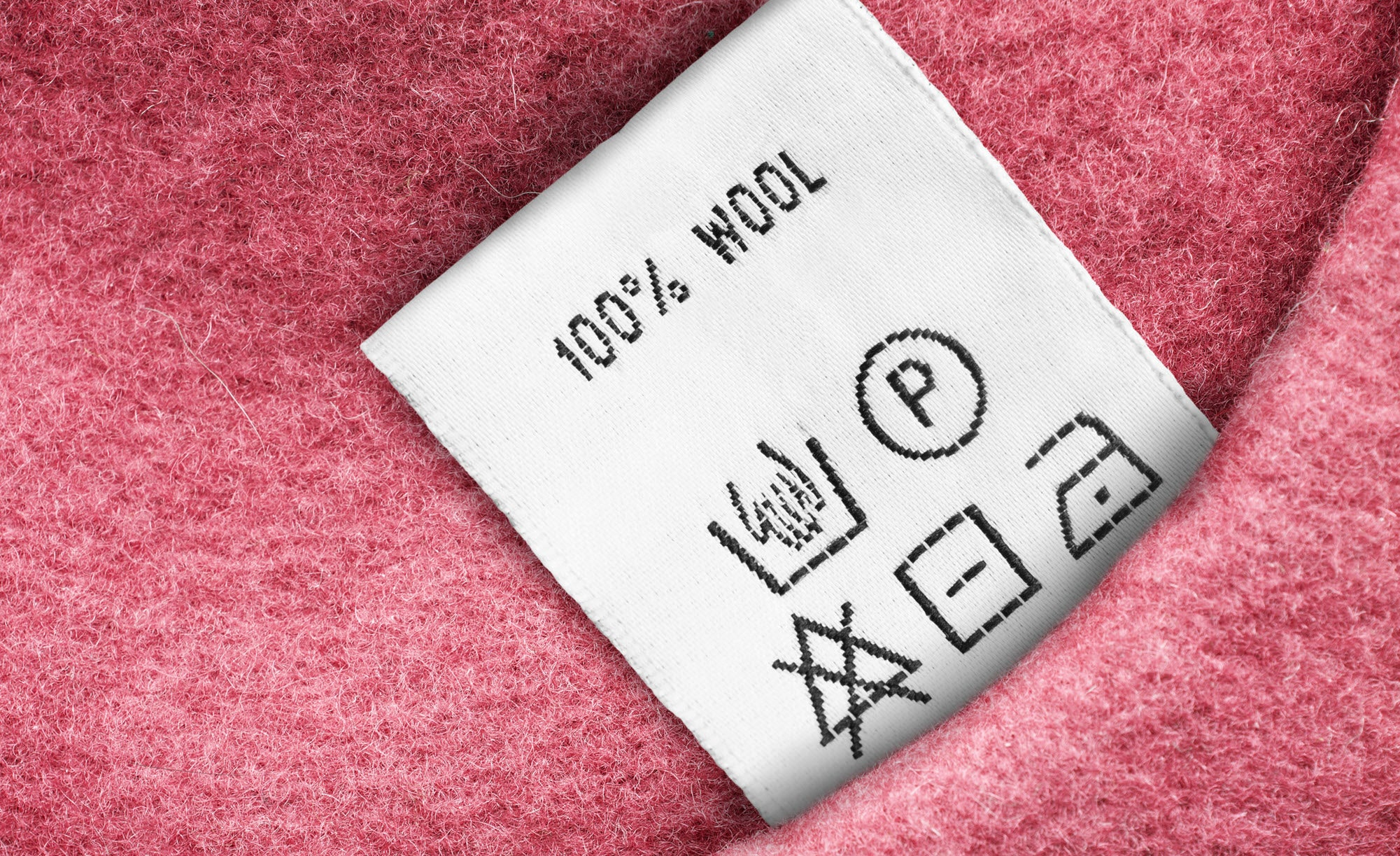 Reading a care label for a wool garment
