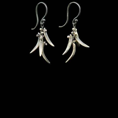 backwards tusks earring
