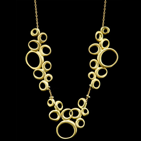 triple cluster dancing oval necklace