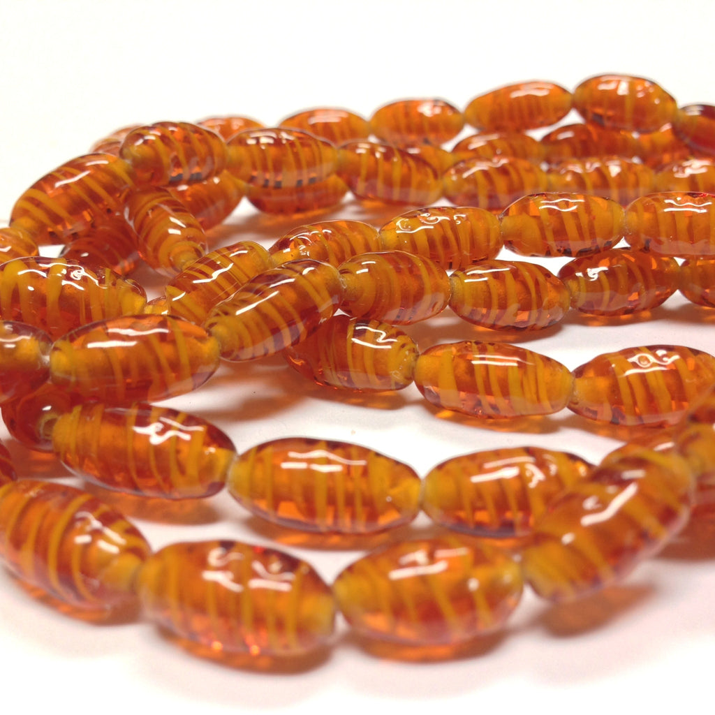 6X12MM Topaz Swirl Glass Oval Bead (72 pieces)