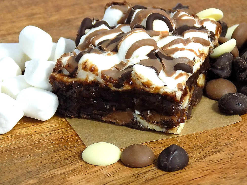 Triple chocolate brownie with melted marshmallows. Homemade from the finest ingredients.
