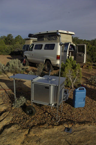 portable camping shower setup at off-grid campsite