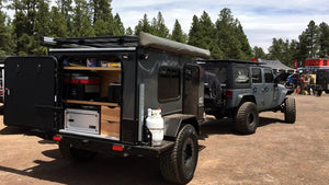 jeep wrangler and overland trailer with compact camp kitchen