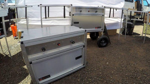 camp kitchen with built in stove and wheels