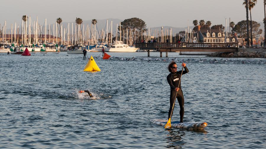A swimmer approaches the finish of the Ironman 70.3 Oceanside swim course.