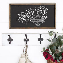 Load image into Gallery viewer, North Pole Santa Supply Company Painted Wood Sign Black Board White Lettering