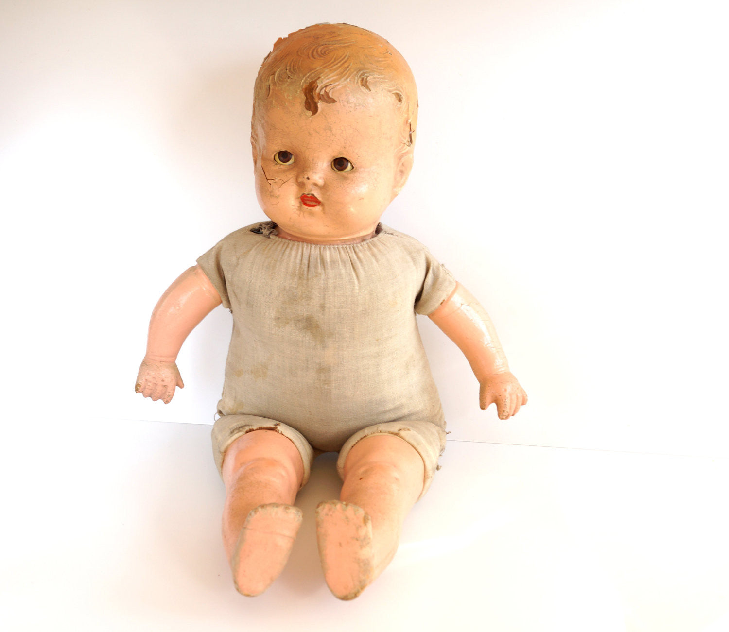 Vintage Sleepy Eye position Baby Doll with Molded Hair and Cloth