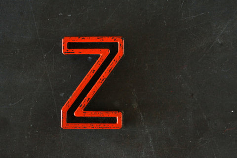 "Vintage Industrial Letter ""Z"" Black with Orange and Blue Paint, 2"" tall (c.1940s) - ThirdShiftVintage.com"
