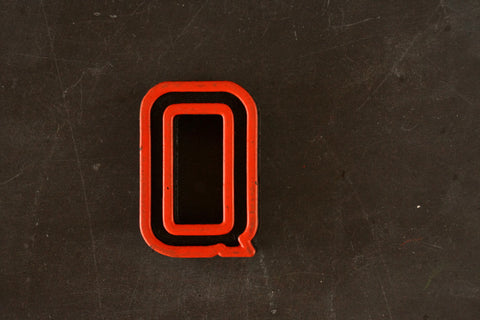"Vintage Industrial Letter ""Q"" Black with Orange and Green Paint, 2"" tall (c.1940s) - ThirdShiftVintage.com"
