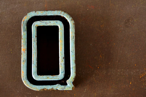 "Vintage Industrial Letter ""Q"" Black with Light Blue and Light Green Paint, 2"" tall (c.1940s) - thirdshift"
