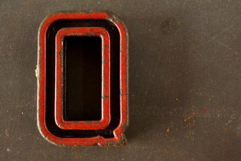 "Vintage Industrial Letter ""Q"" Black with Red and Green Paint, 2"" tall (c.1940s) - ThirdShiftVintage.com"