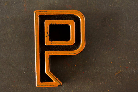 "Vintage Industrial Letter ""P"" Black with Light Orange and Blue Paint, 2"" tall (c.1940s) - thirdshift"