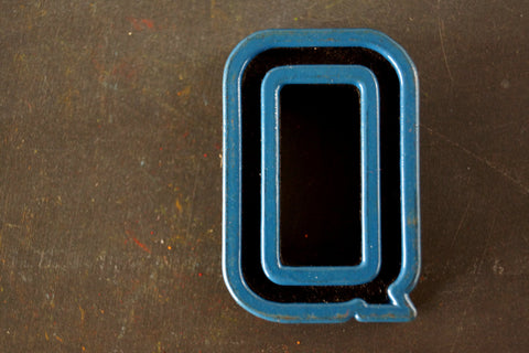 "Vintage Industrial Letter ""Q"" Black with Blue and Orange Paint, 2"" tall (c.1940s) - ThirdShiftVintage.com"