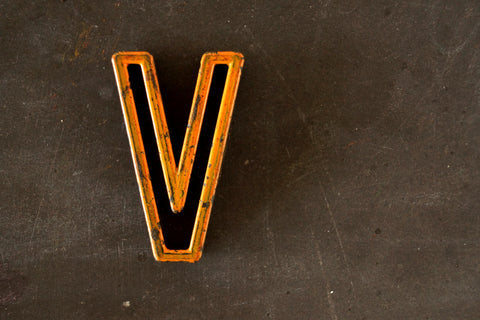 "Vintage Industrial Letter ""V"" Black with Light Orange and Blue Paint, 2"" tall (c.1940s) - thirdshift"