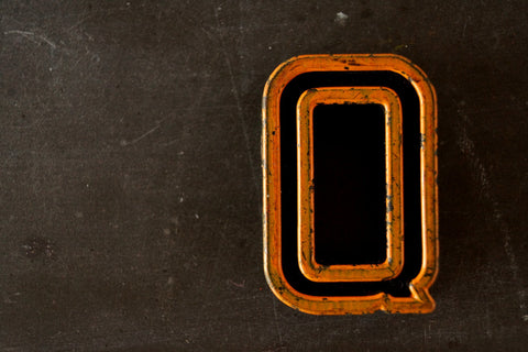 "Vintage Industrial Letter ""Q"" Black with Light Orange and Green Paint, 2"" tall (c.1940s) - ThirdShiftVintage.com"