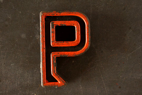 "Vintage Industrial Letter ""P"" Black with Orange and Blue Paint, 2"" tall (c.1940s) - thirdshift"