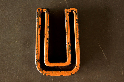 "Vintage Industrial Letter ""U"" Black with Light Orange and Blue Paint, 2"" tall (c.1940s) - thirdshift"
