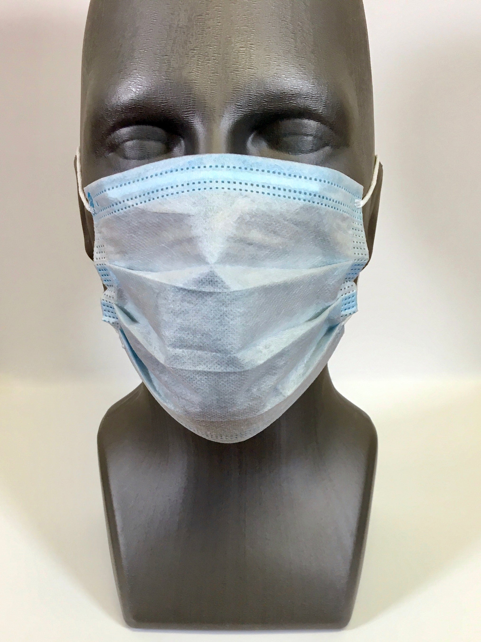 Protective Face Mask being worn on a mannequin head. The Mask covers nose and chin with a concealed moldable nose bridge.