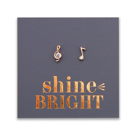 Tiny musical note earrings in a card saying 'SHINE BRIGHT'