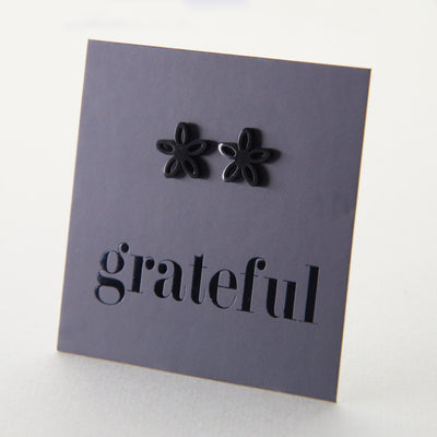 Stainless Steel Geo flower shape earrings. Hypoallergenic studs in Rose Gold, Silver, Black & Gold. Star shaped. Beautiful Gifts by Sister and Soul. Foil feature gift card Girl you are amazing.