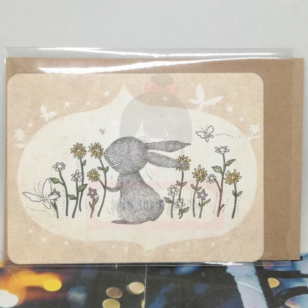 Rabbit Loving Flowers Greeting Card