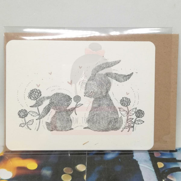 Rabbit With Flowers Greeting Card