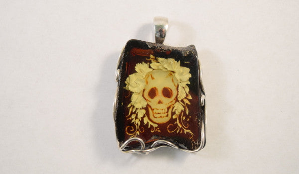Carved Amber Pendant