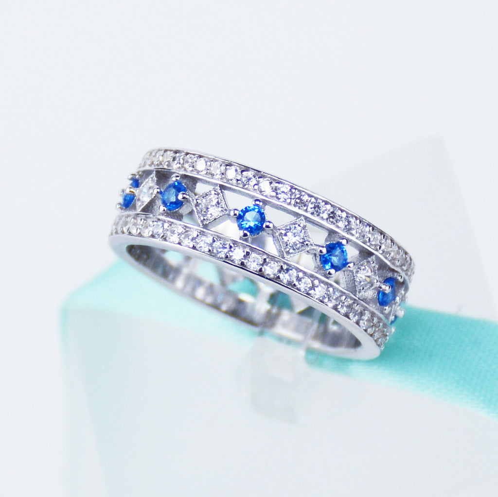 Simulated Diamond And Blue Topaz Womens Wedding Band In Sterling Silver