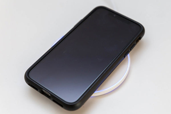 phone on the wireless charging station or wireless charger