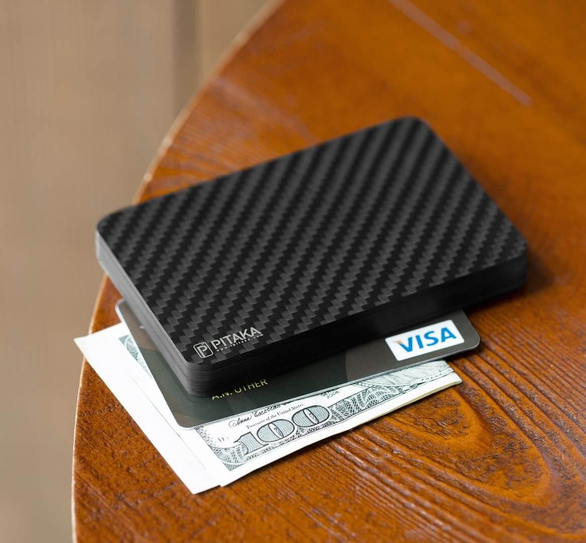 Carbon fiber wallet with cash and card