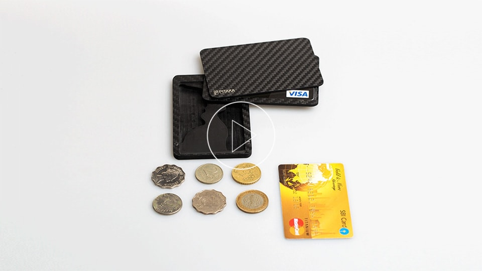 coins into the card holder