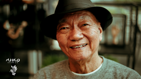 older man with hat smiling