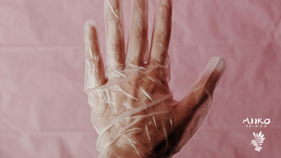 hand in glove with pink background