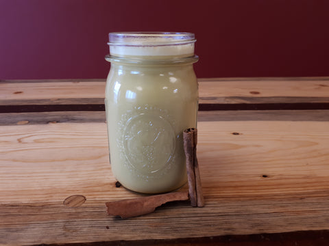 mason jar with turmeric milk with cinnamon